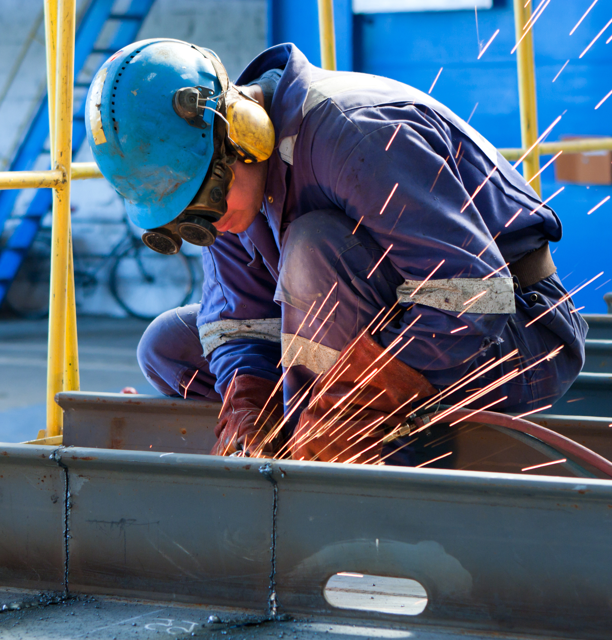 Welder with protective clothing and ecooline